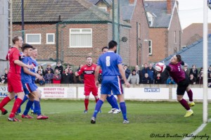 Kevin Burgess header is on its way into the net against Whitby