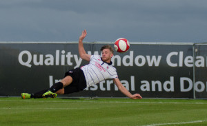 Lee Gaskell acrobatically volleys the fourth