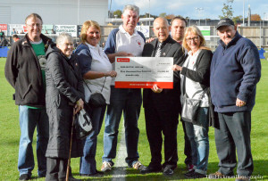 Community notes DFC Lottery Cheque Presentation