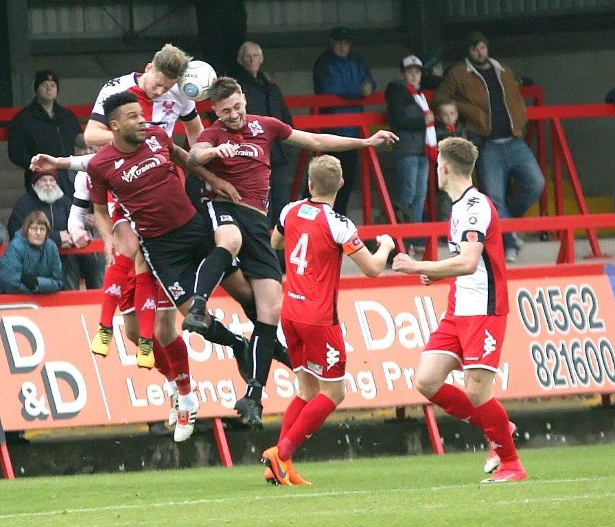 Dominic Collins and Josh Heaton in aerial action at Kidderminster