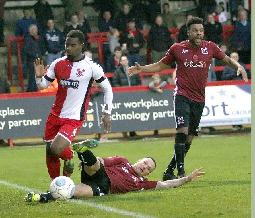 Stephen Thompson slides in for a tackle at Kidderminster (photo Bob Hill)