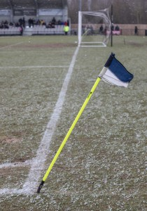 The corner flag takes a battering in the wind