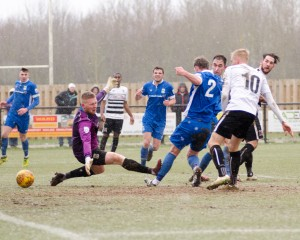 Reece Styche backheels the third v North Ferriby