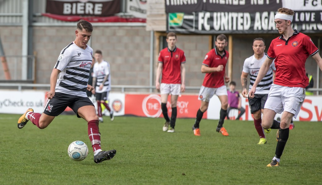 Joe  Wheatley fires in a shot at FC United
