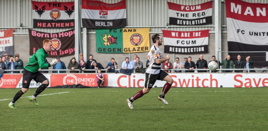 Reece Styche seizes on the loose ball for the winner at FC united
