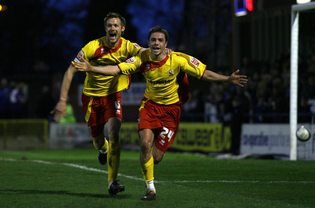 Nathan Mulligan (right) celebrates scoring for Darlington in the first half.