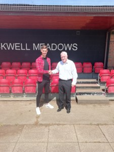 Director John Tempest welcomes Jonny to the club